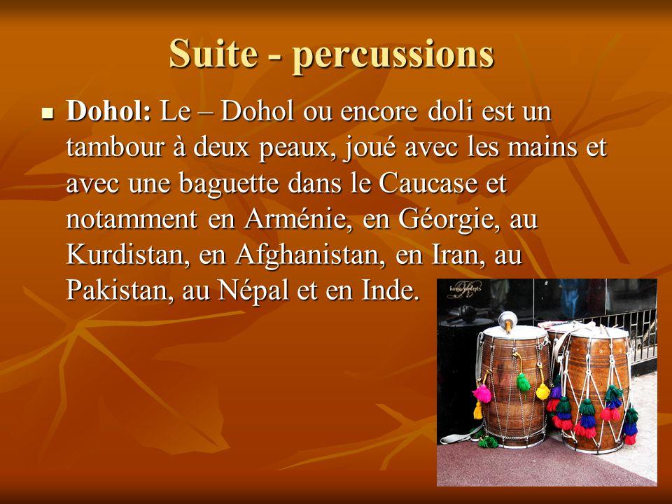 Suite - percussions Dohol: Le – Dohol ou encore doli est un tambour à deux peaux, joué avec les mains et avec une baguette dans le Caucase et notammen