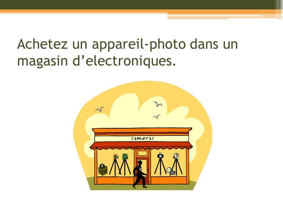 Achetez un appareil-photo dans un magasin delectroniques.
