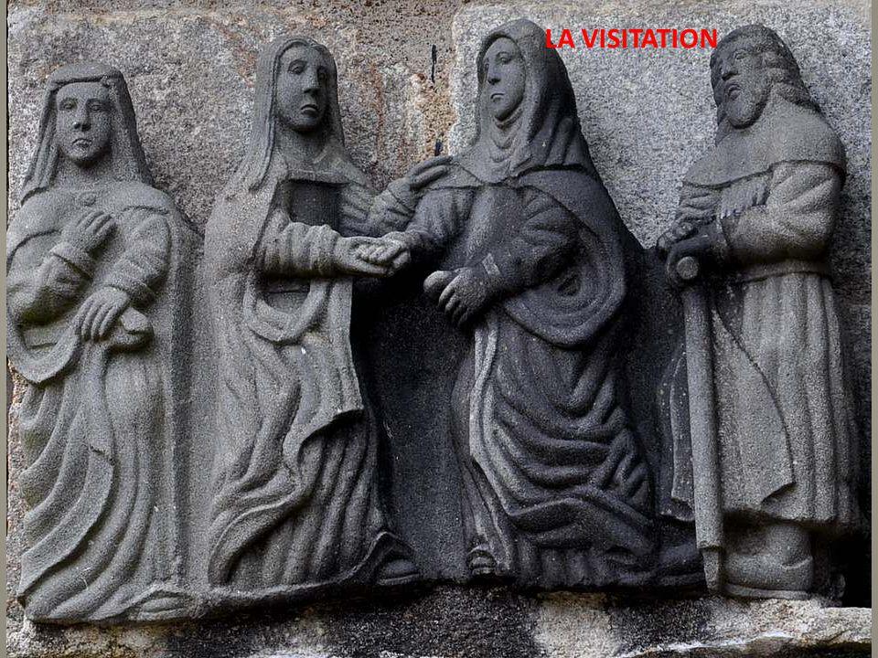 L'Annonciation : Remarquez Dieu-Père, qui tient le globe dans sa main, car il envoie son Fils pour le salut du monde, et l'Esprit-Saint, qui