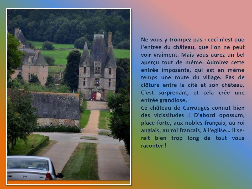 L'église de Carrouges et la belle Madone de la façade.