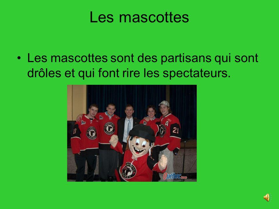 Les mascottes Les mascottes sont des partisans qui sont drôles et qui font rire les spectateurs.