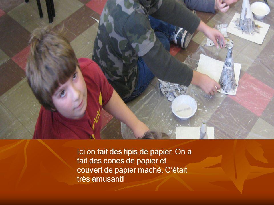 Ici on fait des tipis de papier. On a fait des cones de papier et couvert de papier maché. Cétait très amusant!
