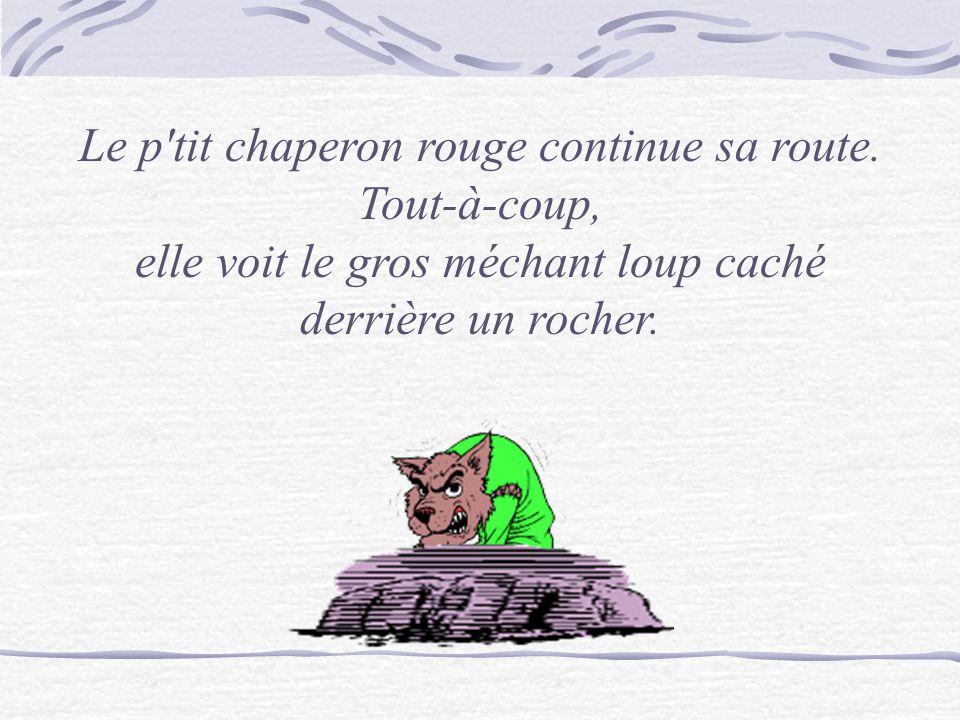 Le p'tit chaperon rouge continue sa route. Tout-à-coup, elle voit le gros méchant loup caché derrière un rocher.