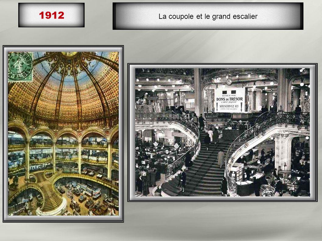 1912 Inauguration du nouveau magasin : 5 étages, sous des balcons, 96 rayons, salon de thé, Salon de coiffure, bibliothèque et terrasse au sommet perm