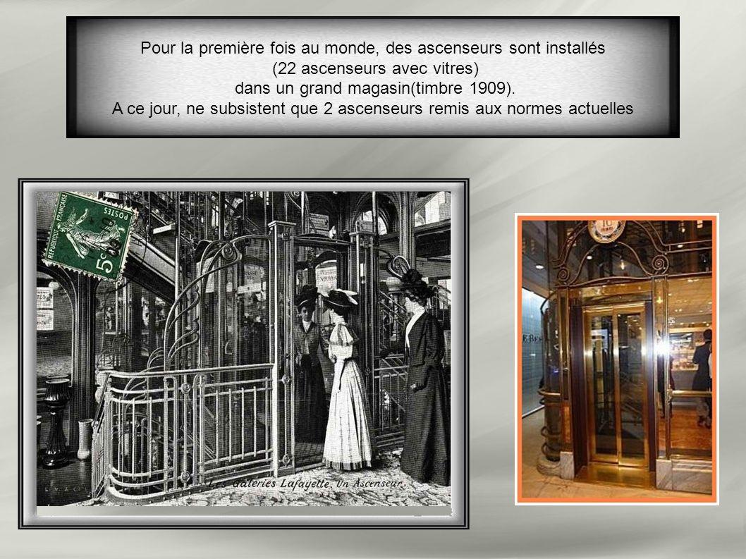 Pour la première fois au monde, des ascenseurs sont installés (22 ascenseurs avec vitres) dans un grand magasin(timbre 1909).
