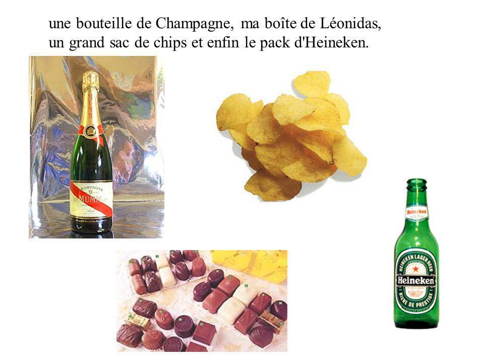 une bouteille de Champagne, ma boîte de Léonidas, un grand sac de chips et enfin le pack d Heineken.