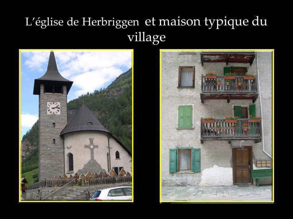 Léglise de Herbriggen et maison typique du village