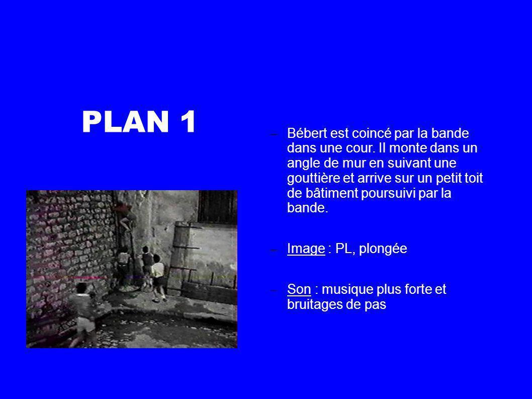 PLAN 2 Bébert se redresse sur le toit et empêche son premier poursuivant de le suivre.