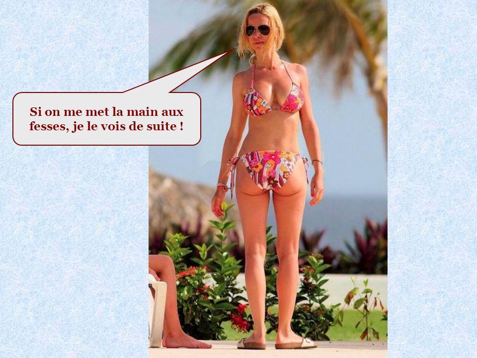 Voici une femme en bikini : Voir photo page suivante