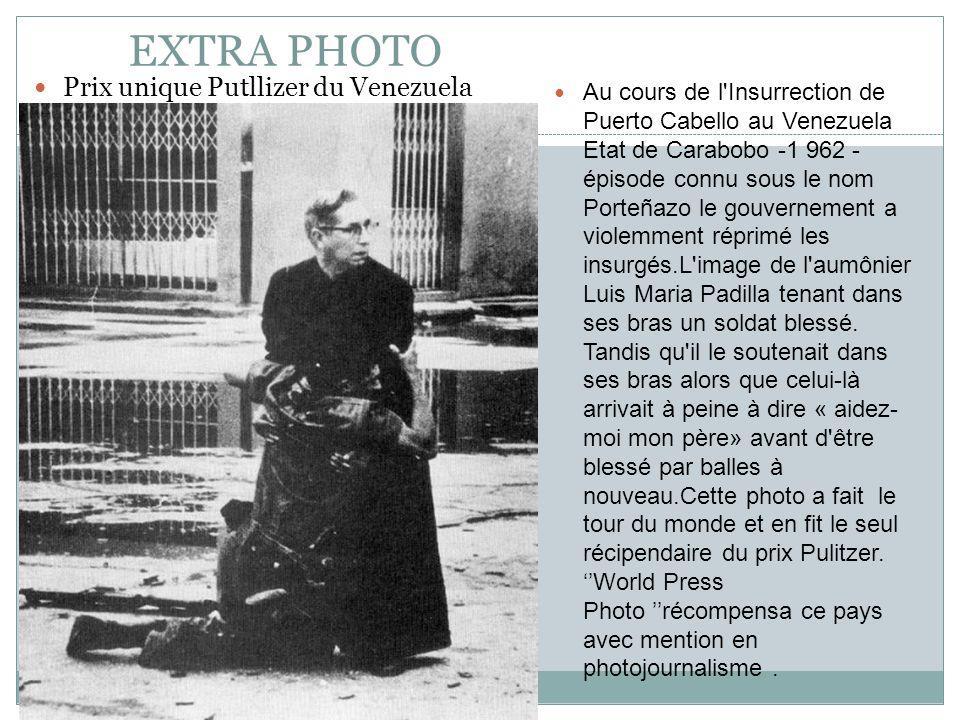 EXTRA PHOTO Prix unique Putllizer du Venezuela Au cours de l Insurrection de Puerto Cabello au Venezuela Etat de Carabobo -1 962 - épisode connu sous le nom Porteñazo le gouvernement a violemment réprimé les insurgés.L image de l aumônier Luis Maria Padilla tenant dans ses bras un soldat blessé.