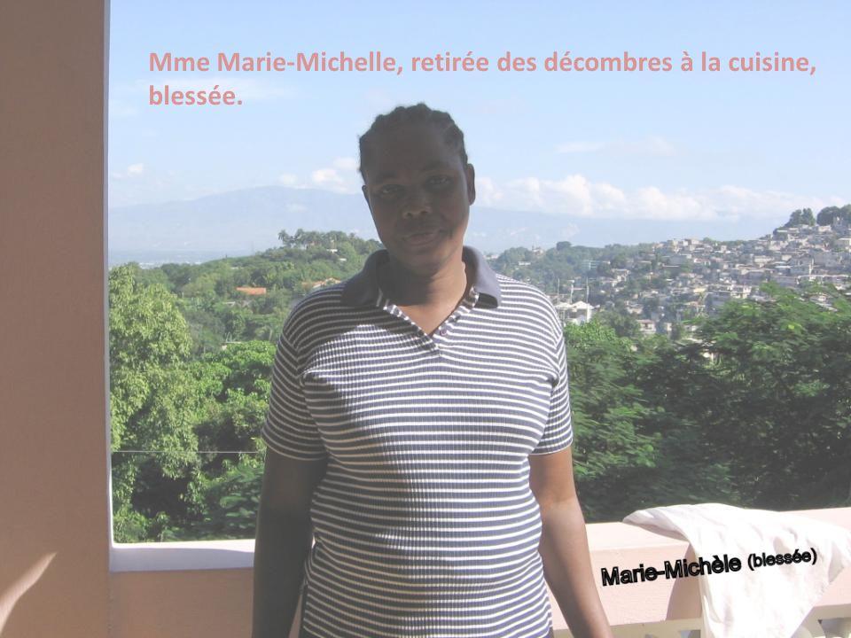 Mme Marie-Michelle, retirée des décombres à la cuisine, blessée.