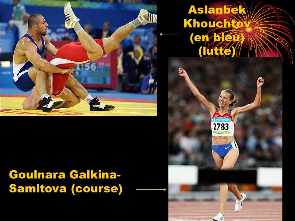 Aslanbek Khouchtov (en bleu) (lutte) Goulnara Galkina- Samitova (course)