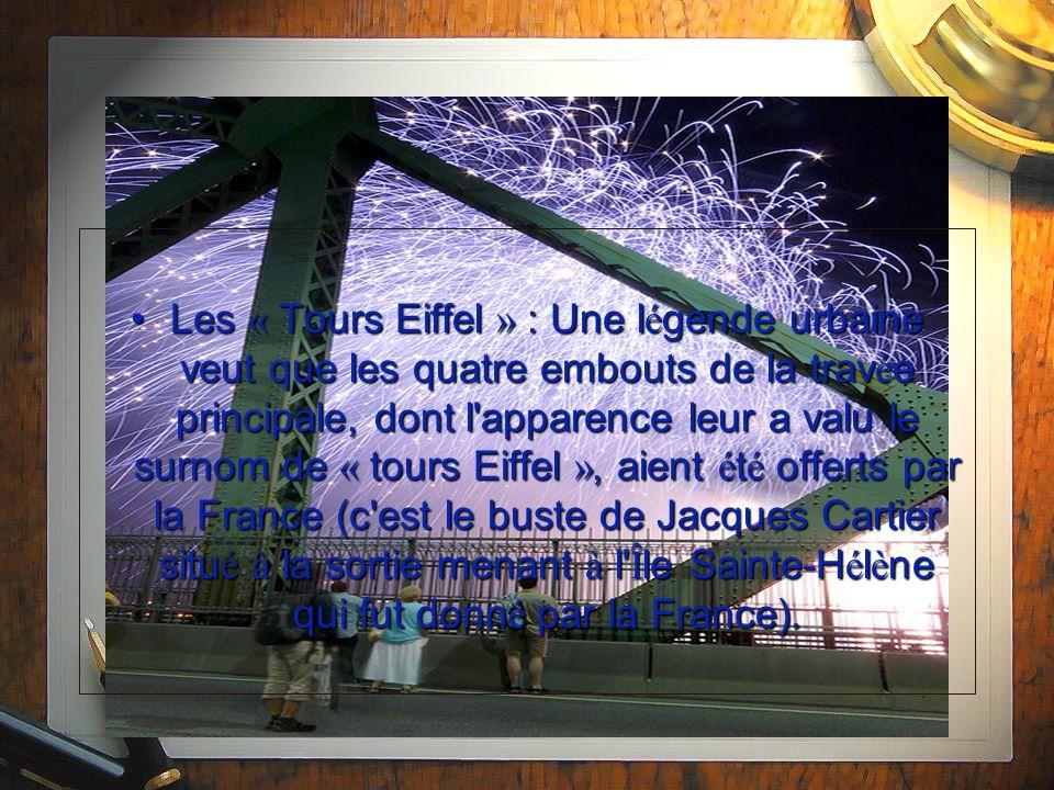 Les « Tours Eiffel » : Une l é gende urbaine veut que les quatre embouts de la trav é e principale, dont l apparence leur a valu le surnom de « tours Eiffel », aient é t é offerts par la France (c est le buste de Jacques Cartier situ é à la sortie menant à l Î le Sainte-H é l è ne qui fut donn é par la France).Les « Tours Eiffel » : Une l é gende urbaine veut que les quatre embouts de la trav é e principale, dont l apparence leur a valu le surnom de « tours Eiffel », aient é t é offerts par la France (c est le buste de Jacques Cartier situ é à la sortie menant à l Î le Sainte-H é l è ne qui fut donn é par la France).