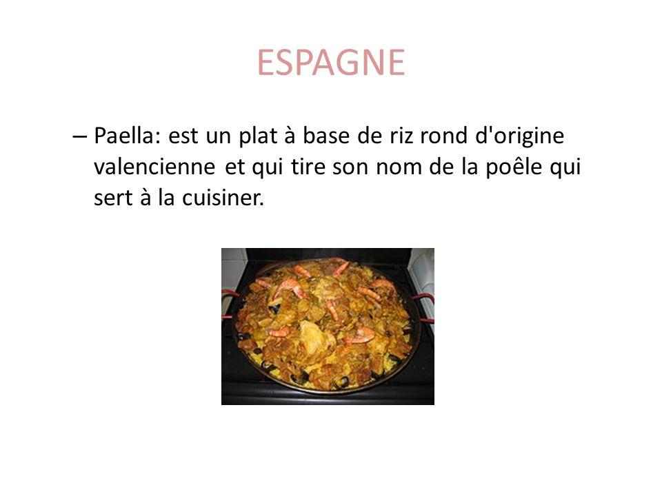 ESPAGNE – Paella: est un plat à base de riz rond d'origine valencienne et qui tire son nom de la poêle qui sert à la cuisiner.
