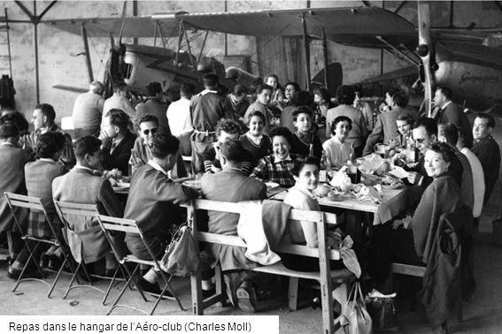 Repas dans le hangar de lAéro-club (Charles Moll)