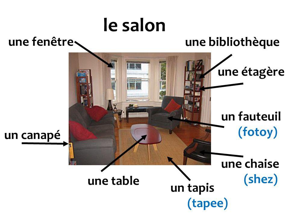 le salon un canapé une chaise (shez) un fauteuil (fotoy) une table un tapis (tapee) une bibliothèque une étagère une fenêtre