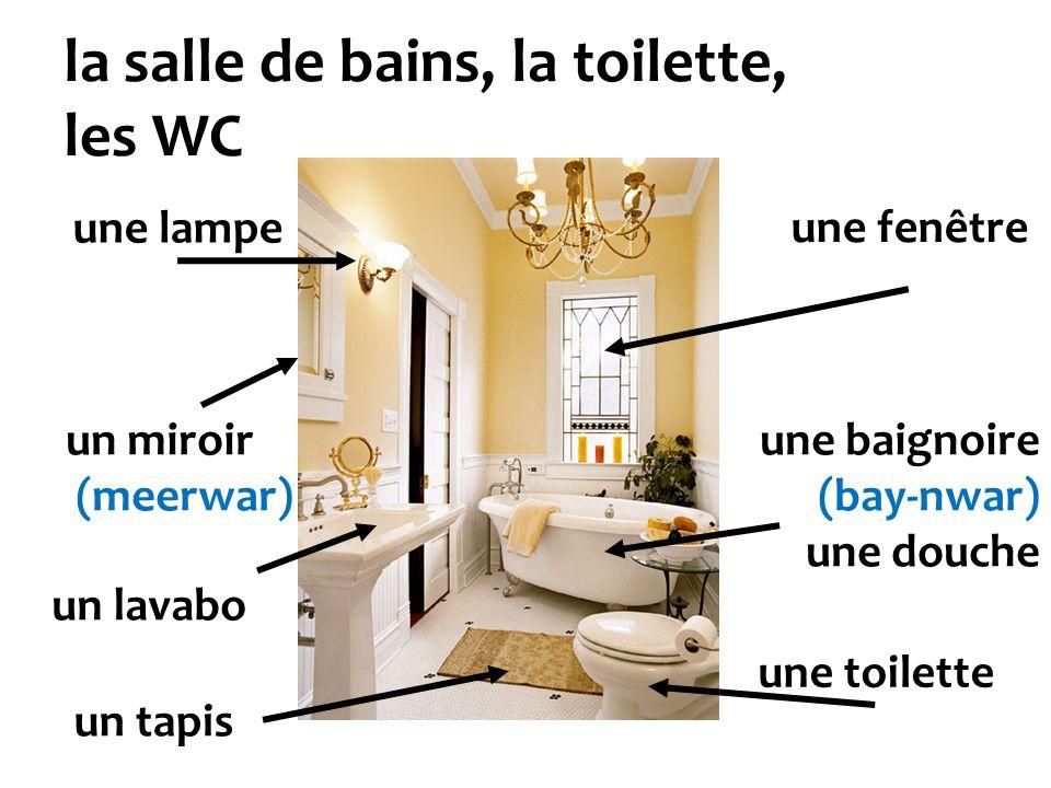 la salle de bains, la toilette, les WC une baignoire (bay-nwar) une douche une toilette une fenêtre une lampe un miroir (meerwar) un lavabo un tapis