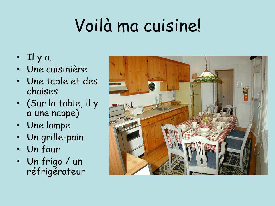 Voilà ma cuisine! Il y a… Une cuisinière Une table et des chaises (Sur la table, il y a une nappe) Une lampe Un grille-pain Un four Un frigo / un réfr