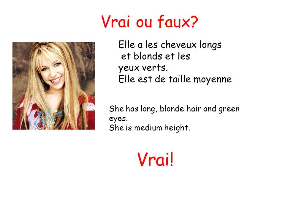 Elle a les cheveux longs et blonds et les yeux verts. Elle est de taille moyenne She has long, blonde hair and green eyes. She is medium height. Vrai