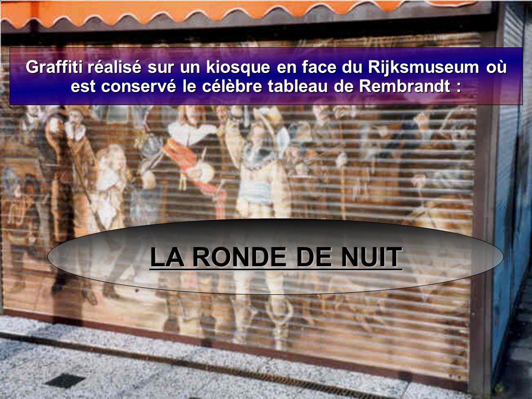 Graffiti réalisé sur un kiosque en face du Rijksmuseum où est conservé le célèbre tableau de Rembrandt : LA RONDE DE NUIT