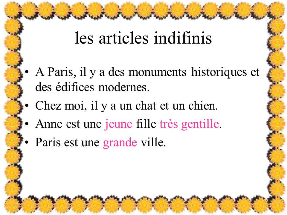 les articles indifinis A Paris, il y a des monuments historiques et des édifices modernes. Chez moi, il y a un chat et un chien. Anne est une jeune fi