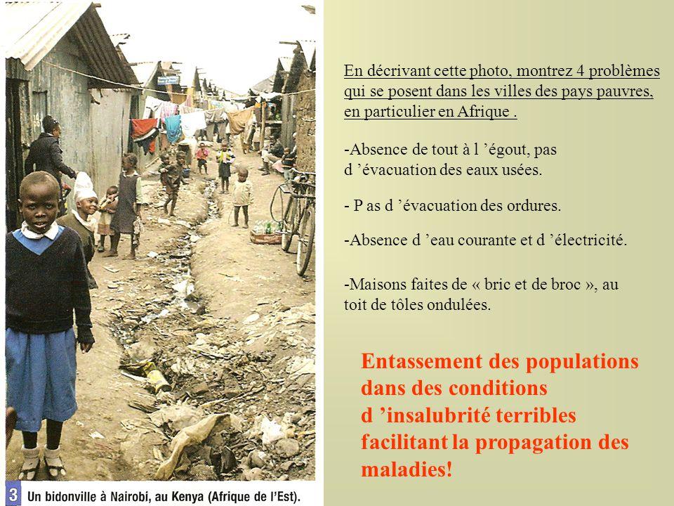 En décrivant cette photo, montrez 4 problèmes qui se posent dans les villes des pays pauvres, en particulier en Afrique. -Absence de tout à l égout, p
