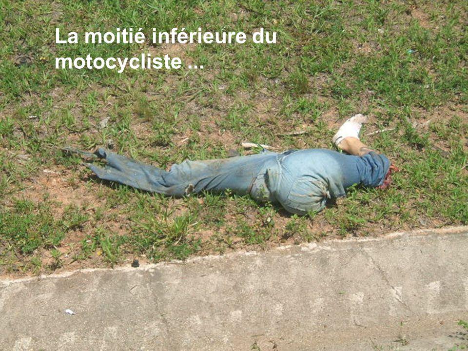 La moitié inférieure du motocycliste...