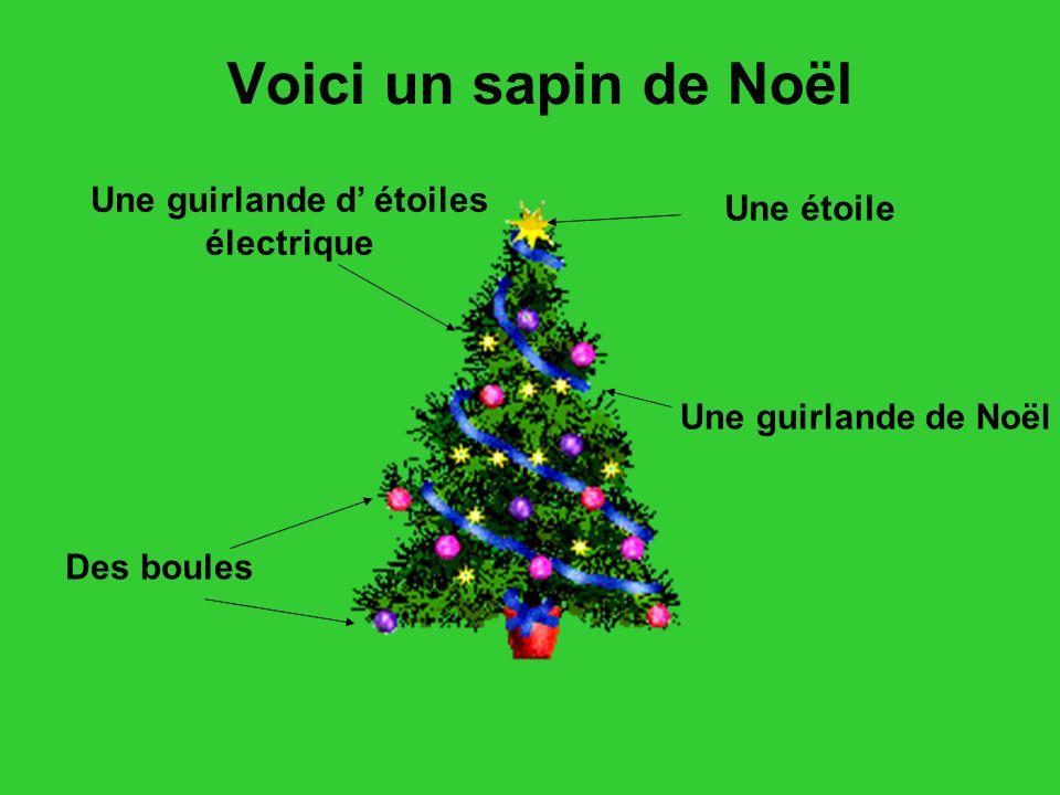 Voici un sapin de Noël Des boules Une étoile Une guirlande de Noël Une guirlande d étoiles électrique