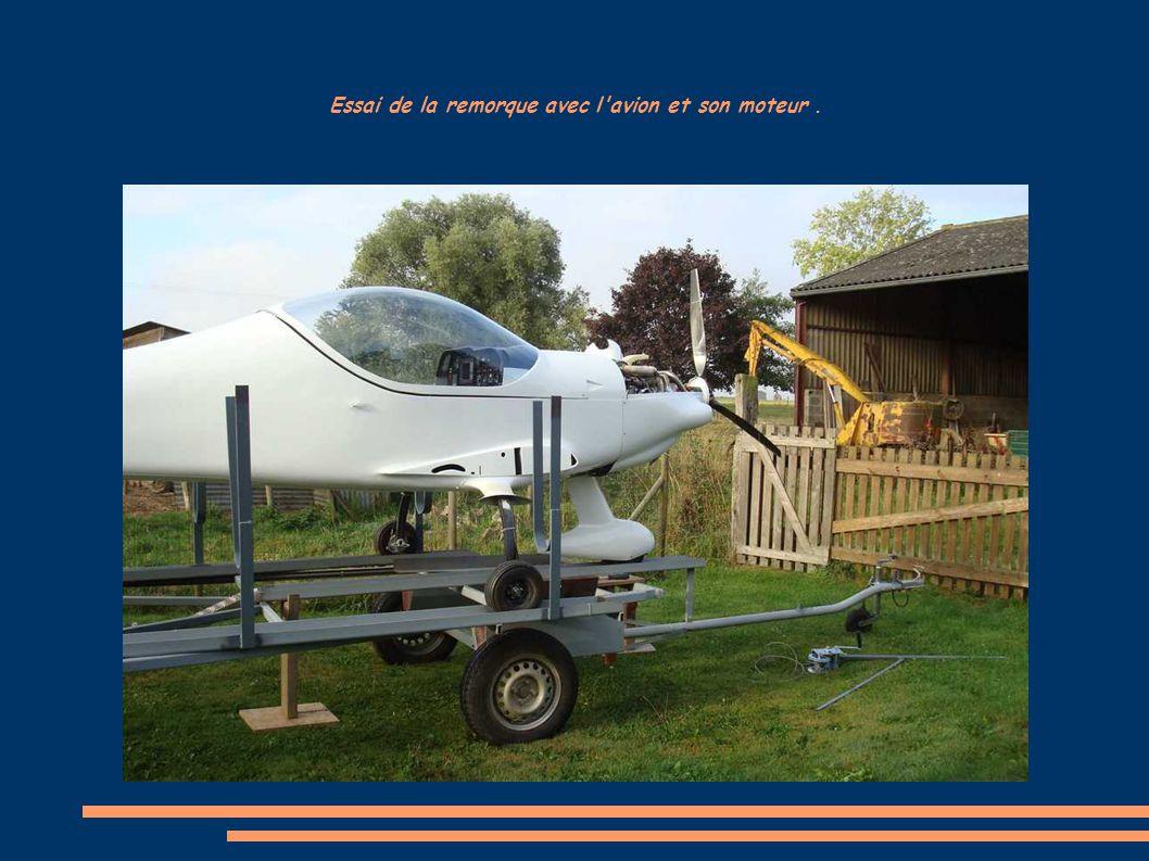 Essai de la remorque avec l'avion et son moteur.