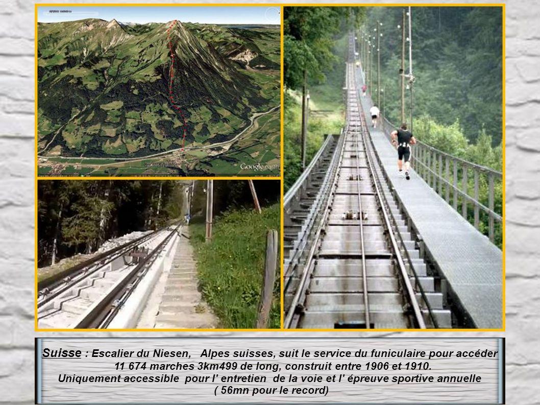 Suisse : Escalier du Niesen, Alpes suisses, suit le service du funiculaire pour accéder 11 674 marches 3km499 de long, construit entre 1906 et 1910.