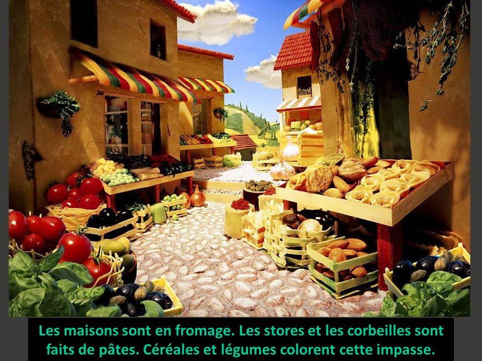 Les maisons sont en fromage. Les stores et les corbeilles sont faits de pâtes. Céréales et légumes colorent cette impasse.