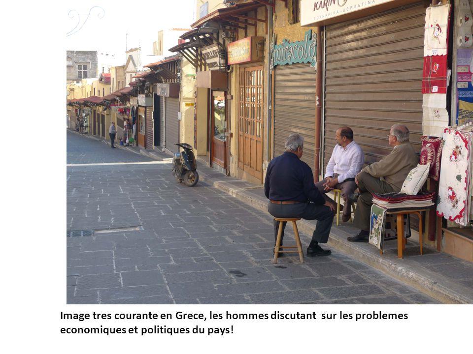 Image tres courante en Grece, les hommes discutant sur les problemes economiques et politiques du pays!