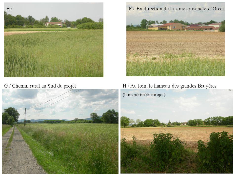 I / Une perception très faible depuis la RD306 – hameau des Grandes Bruyères J / Chemin rural en limite Sud du projet Alignement de chênes (hors périmètre du projet), masquant une partie du front Sud du projet de ZA
