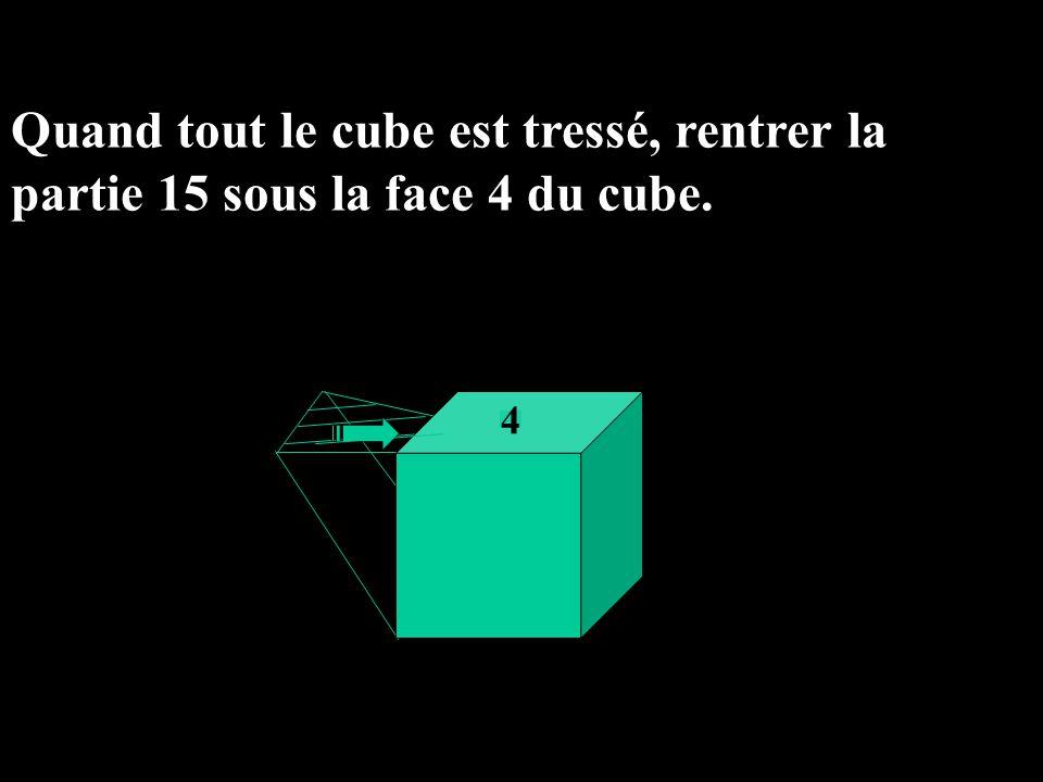 Quand tout le cube est tressé, rentrer la partie 15 sous la face 4 du cube. 4