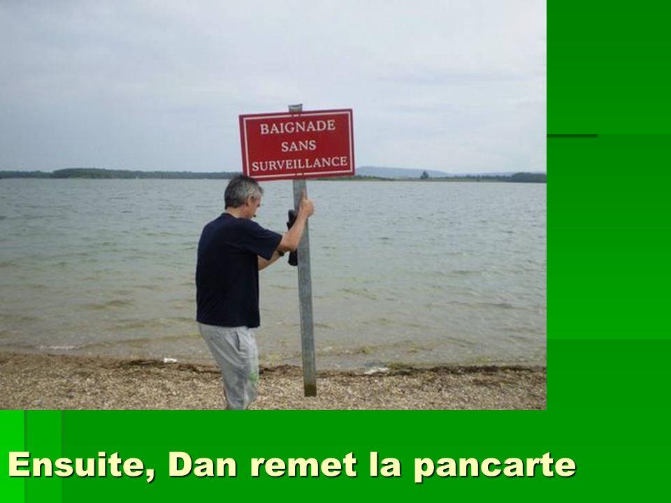Ensuite, Dan remet la pancarte