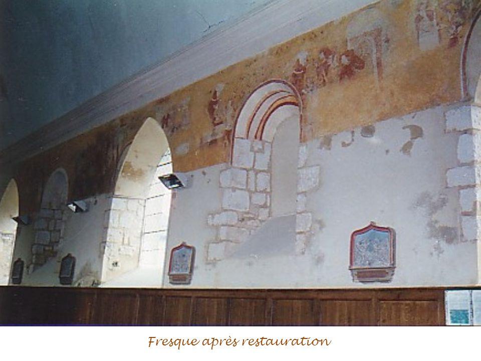 Fenêtre romane et partie de fresque après restauration