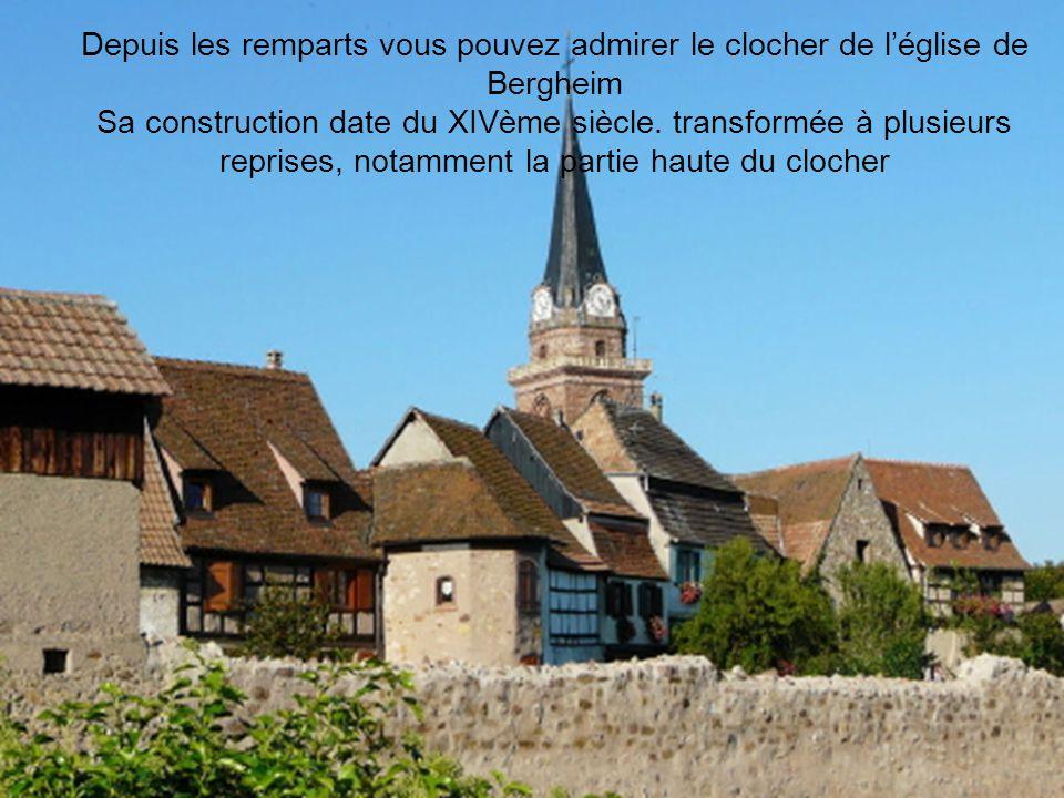 Depuis les remparts vous pouvez admirer le clocher de léglise de Bergheim Sa construction date du XIVème siècle.