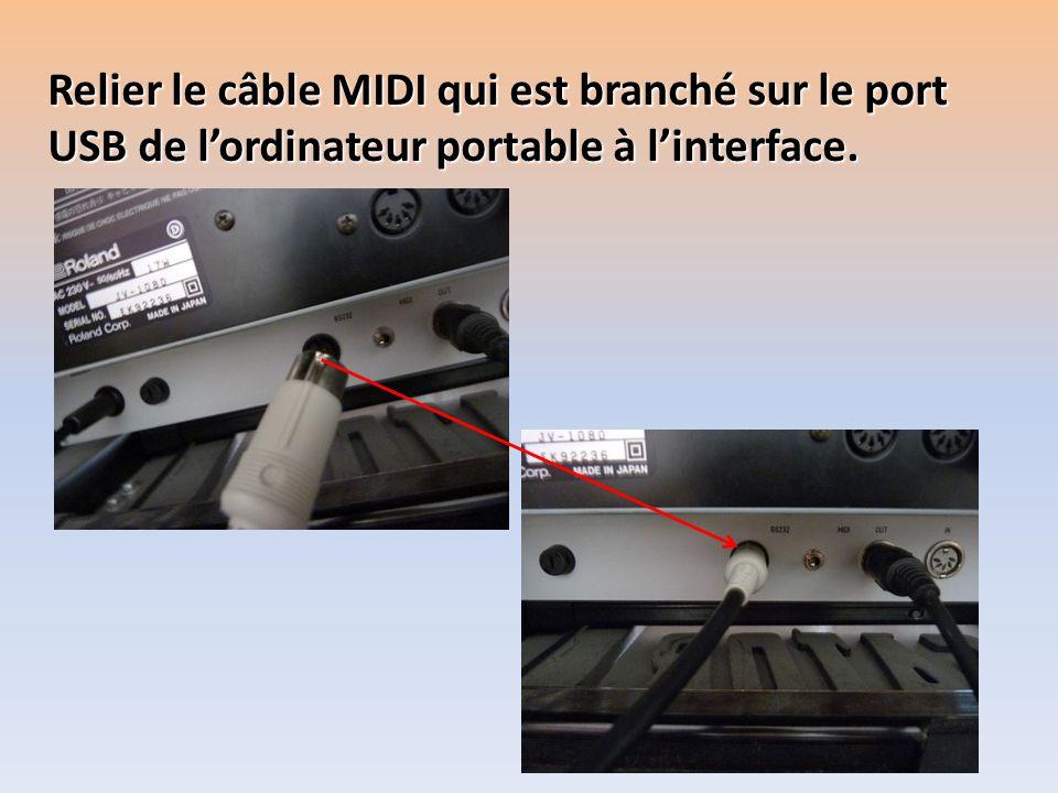 Relier le câble MIDI qui est branché sur le port USB de lordinateur portable à linterface.