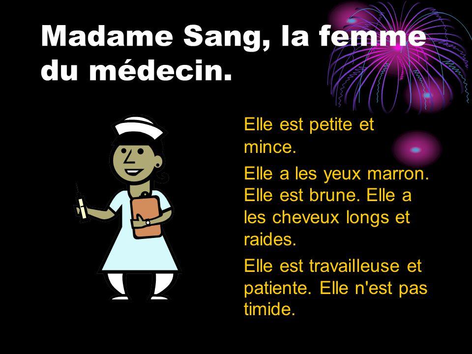 Madame Sang, la femme du médecin. Elle est petite et mince.