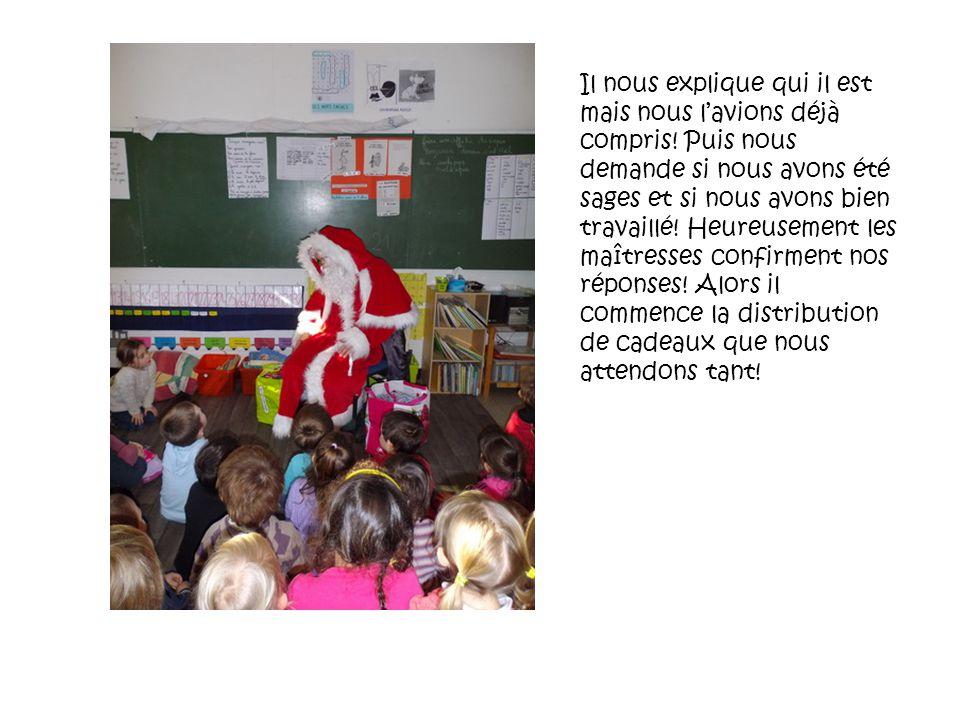 Le père Noël commence par la classe des MS: Jules ouvre un premier paquet Puis cest au tour de Smailey Cest au tour de Aurore douvrir le troisième paquet.