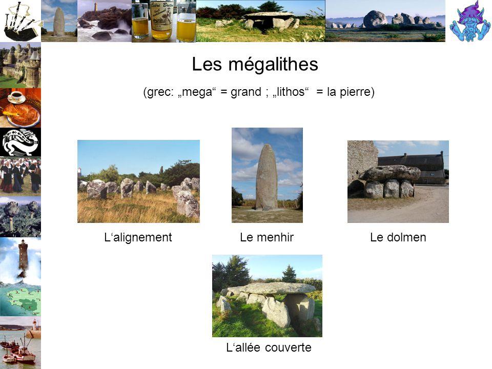 """Les mégalithes (grec: """"mega = grand ; """"lithos = la pierre) L'alignementLe menhirLe dolmen L'allée couverte"""