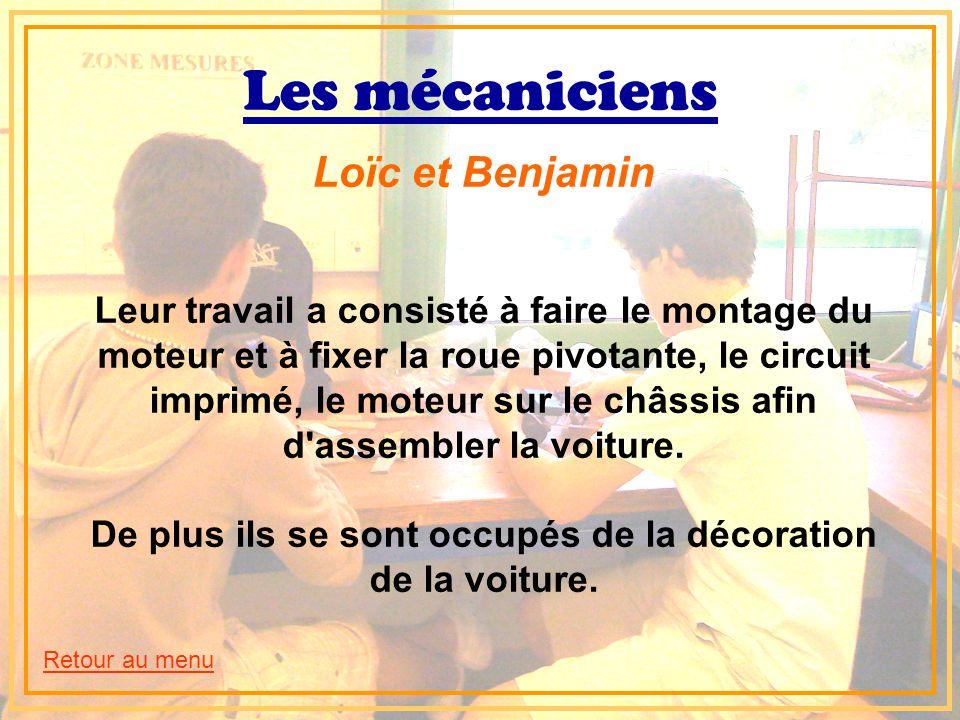 Les mécaniciens Loïc et Benjamin Leur travail a consisté à faire le montage du moteur et à fixer la roue pivotante, le circuit imprimé, le moteur sur