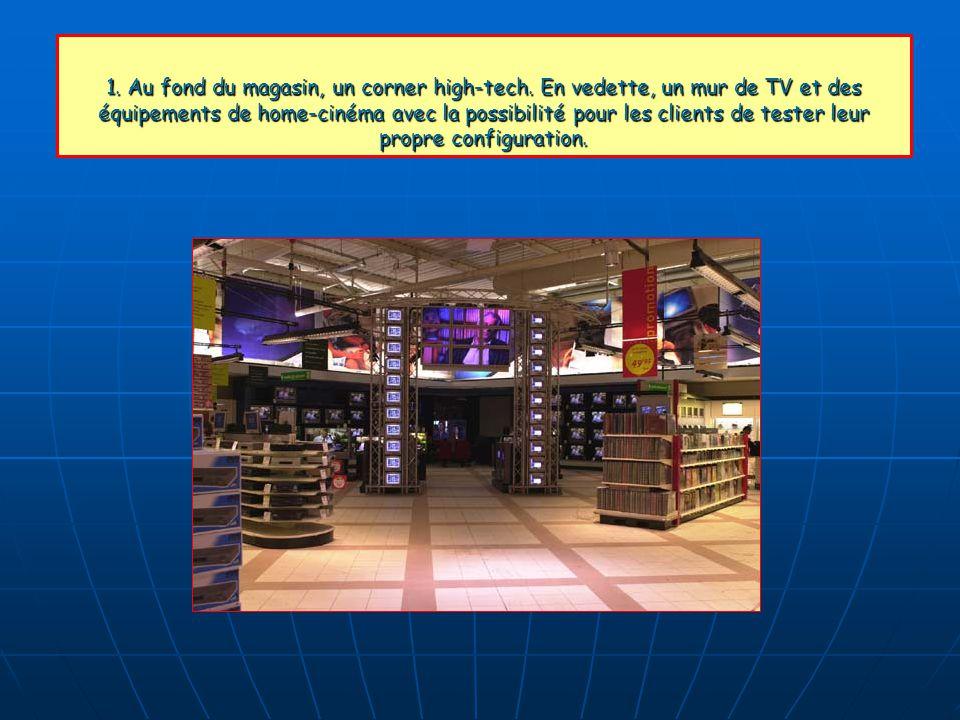 1. Au fond du magasin, un corner high-tech. En vedette, un mur de TV et des équipements de home-cinéma avec la possibilité pour les clients de tester