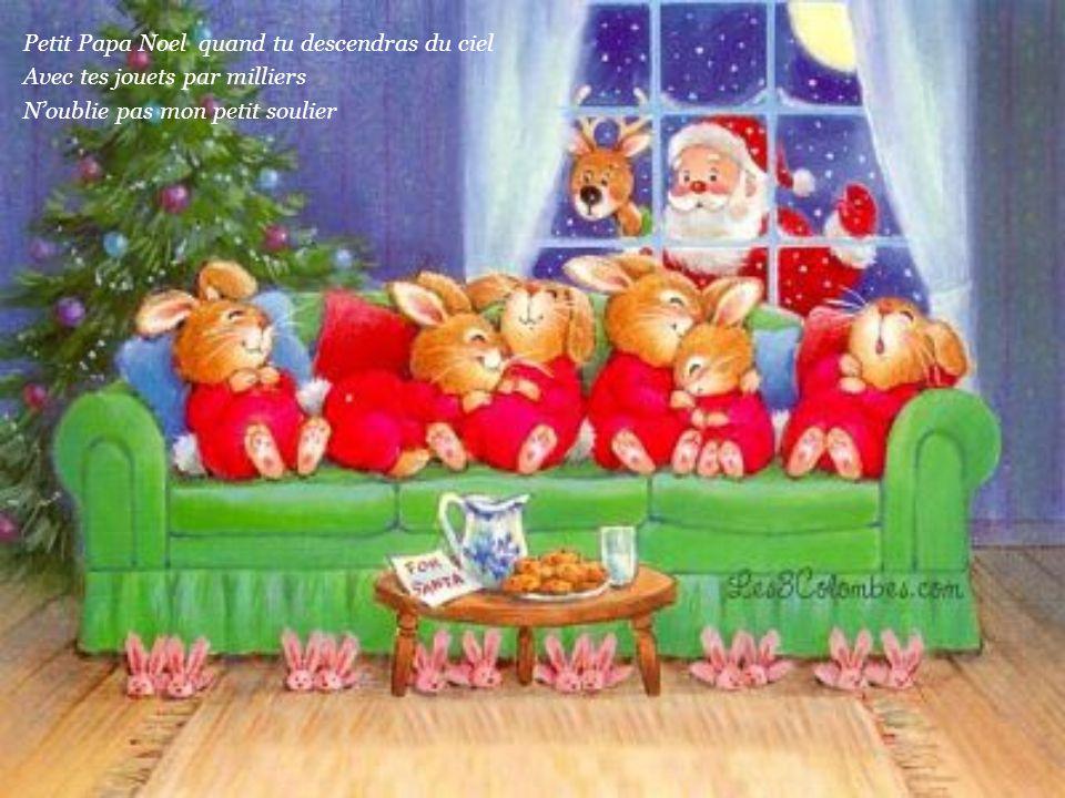 Petit Papa Noel quand tu descendras du ciel Avec tes jouets par milliers N'oublie pas mon petit soulier