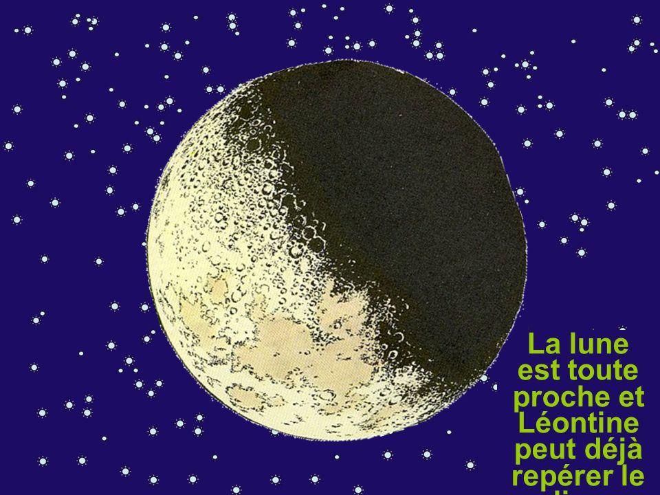 A présent, Léontine peut continuer sa route. La lune est toute proche et Léontine peut déjà repérer le lieu d'alunissa ge.