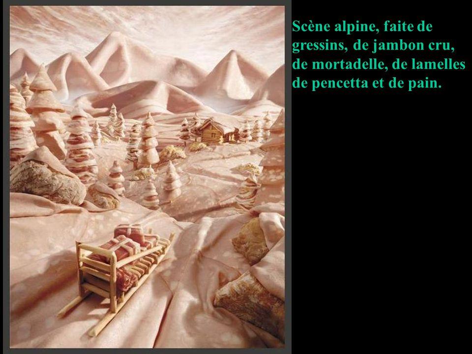 Scène alpine, faite de gressins, de jambon cru, de mortadelle, de lamelles de pencetta et de pain.