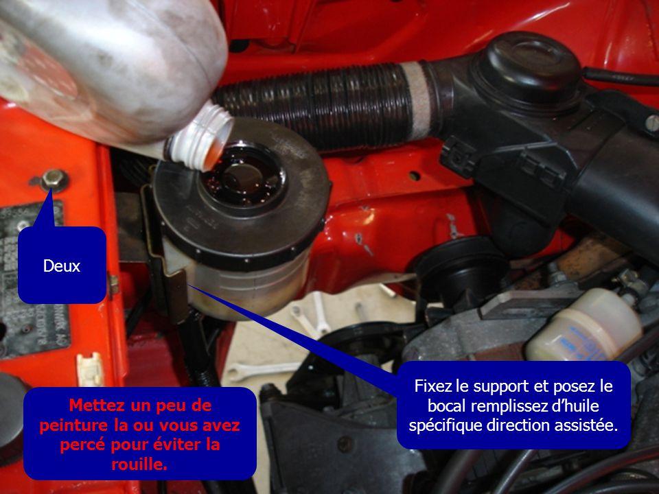 Deux Fixez le support et posez le bocal remplissez d'huile spécifique direction assistée. Mettez un peu de peinture la ou vous avez percé pour éviter