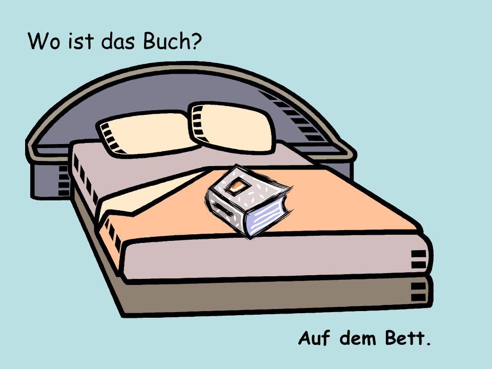Wo ist das Buch? Auf dem Bett.