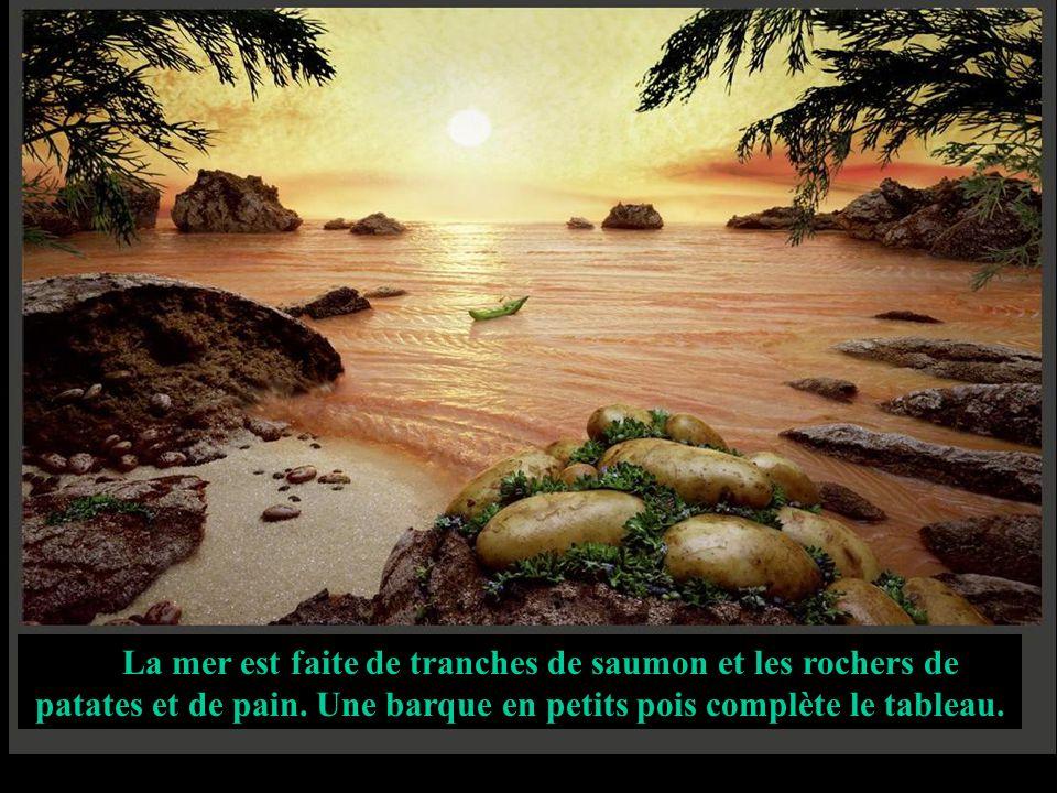 La mer est faite de tranches de saumon et les rochers de patates et de pain. Une barque en petits pois complète le tableau.