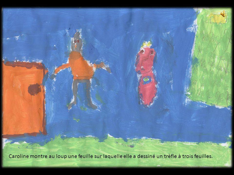 Caroline montre au loup une feuille sur laquelle elle a dessiné un trèfle à trois feuilles.